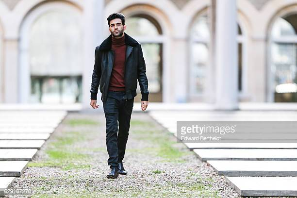 Anil Brancaleoni, digital influencer and youtuber @WaRTek, is wearing a Bodaskin leather jacket, a Sandro red turtleneck pull over, Replay black...