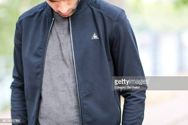 Anil Brancaleoni , is wearing Coq Sportif shoes, Replay black pants, a Replay gray t-shirt, and a Coq Sportif gray jacket, on September 18, 2016 in...