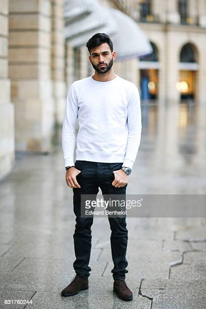 Anil Brancaleoni, life style blogger and Youtuber from the channel Wartek, is wearing Tod's brown denim shoes, Replay black pants, and a Basus white...