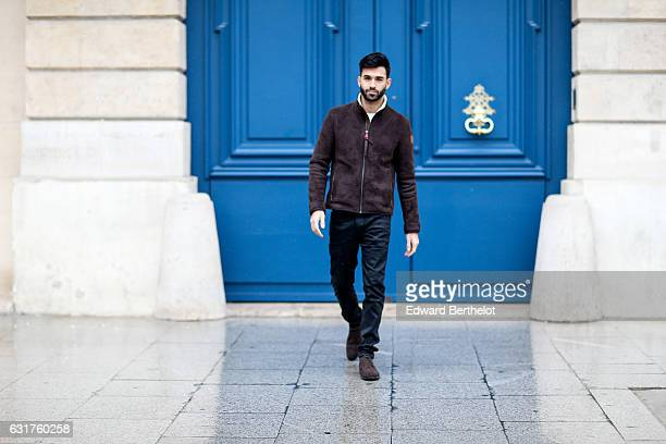 Anil Brancaleoni, life style blogger and Youtuber Wartek, is wearing Tod's brown denim shoes, Replay black pants, and a Napapijri coat, on January...