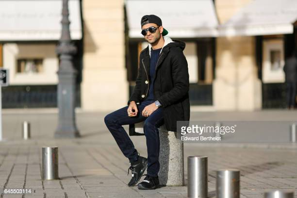 Anil Brancaleoni, Youtube influencer known as Wartek and blogger, wears Puma black shoes, Replay black denim jeans pants, a Gant blue pull over, a...