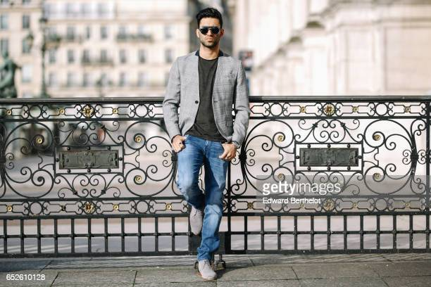 Anil Brancaleoni Youtube influencer Wartek and blogger wears Bobbies gray suede shoes Replay blue denim jeans pants a Replay tshirt sunglasses and an...