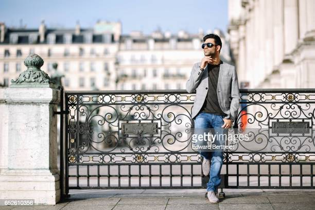 Anil Brancaleoni, Youtube influencer Wartek and blogger, wears Bobbies gray suede shoes, Replay blue denim jeans pants, a Replay t-shirt, sunglasses,...