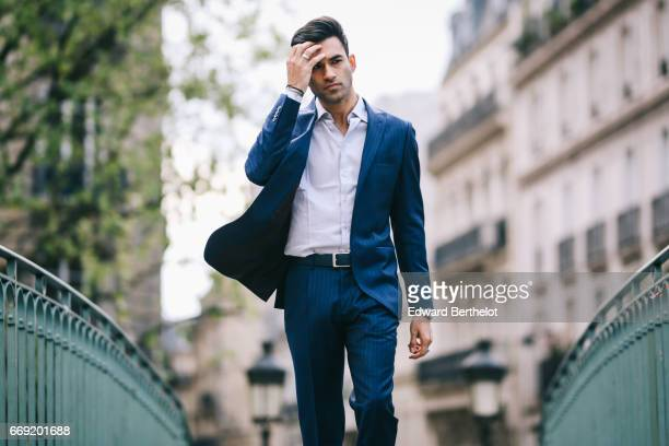 Anil Brancaleoni, Youtube personality and digital influencer WaRTeK, wears a Lanieri blue suit, a Boggi white shirt, Doucal's shoes, and a bracelet...