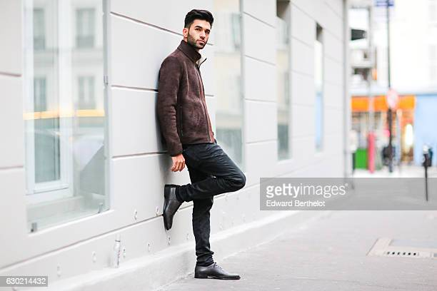 Anil Brancaleoni, youtuber and digital influencer @Wartek, is wearing Doucal's shoes, Replay black denim jeans, a Replay t-shirt, and Napapijri brown...