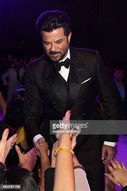 Anil Kapoor greets fans during the Indian Film Festival of Melbourne Awards Night at National Gallery of Victoria on August 15 2015 in Melbourne...