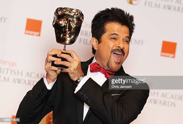 Anil Kapoor poses with his Film Not In The English Language Award during the Orange British Academy Film Awards 2012 at the Royal Opera House on...