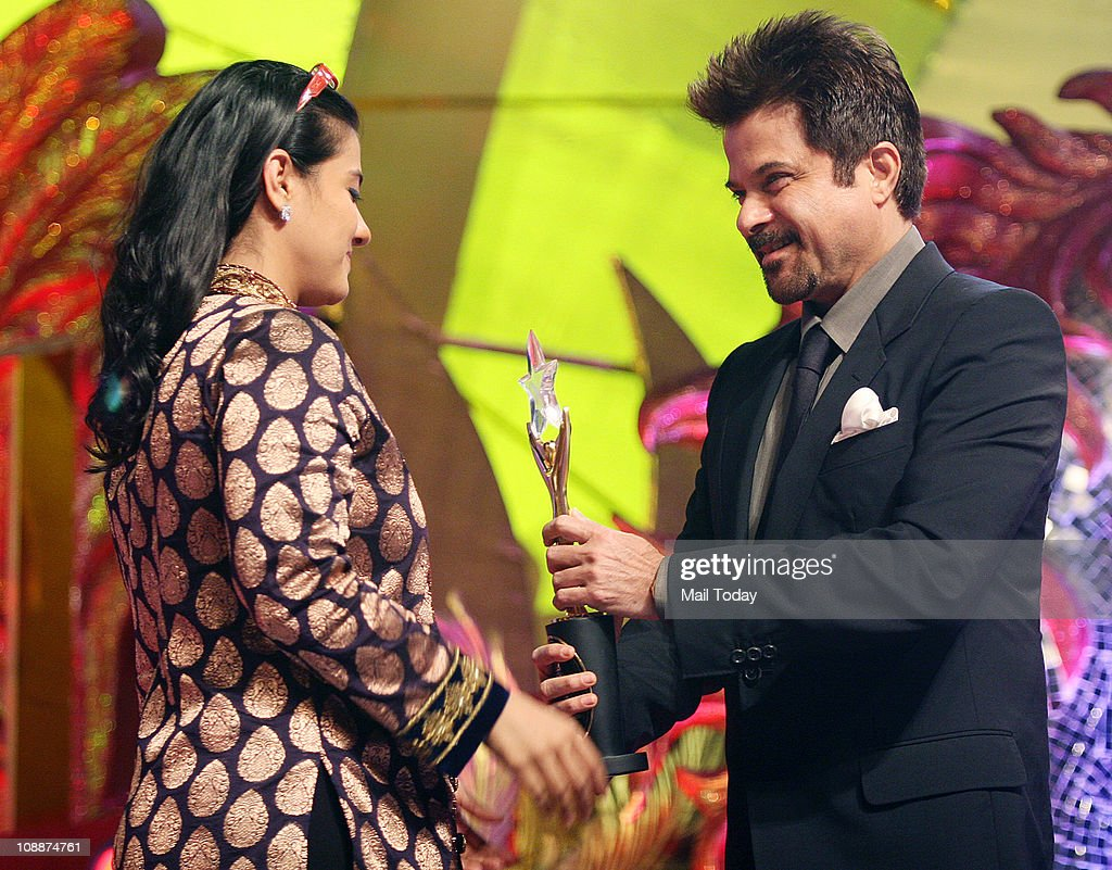 Anil Kapoor presenting an award to Kajol during the Stardust Awards function in Mumbai on Sunday evening