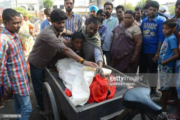 Anil Kumar brother of Satish Kumar who was killed when a train ploughed into a crowd of revellers cries during a cremation ceremony in Amritsar on...