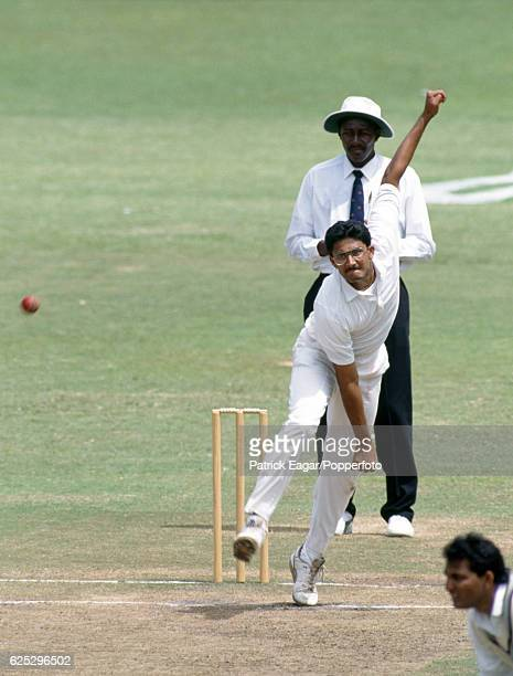 Anil Kumble bowling for India during the 1st Test match between South Africa and India at Kingsmead Durban South Africa 13th November 1992 The umpire...