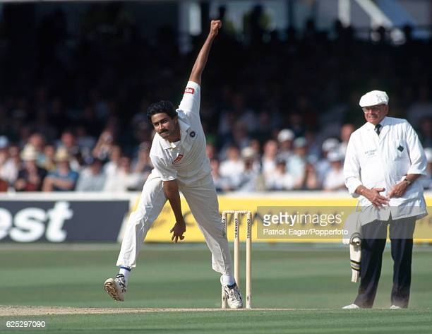 Anil Kumble bowling for India during the 2nd Test match between England and India at Lord's Cricket Ground London 20th June 1996 The umpire is Dickie...