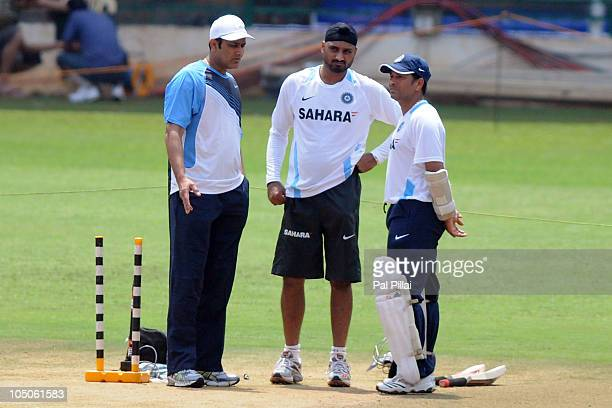 Anil Kumble former Indian cricketer Harbhajan Singh and Sachin Tendulkar of India during an Indian nets session at M Chinnaswamy Stadium on October 8...