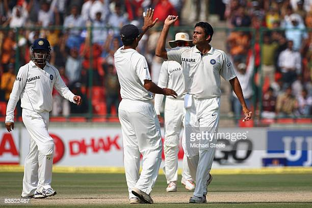 Anil Kumble of India celebrates with Rahul Dravid after capturing the wicket of Brad Haddinduring day four of the Third Test match between India and...