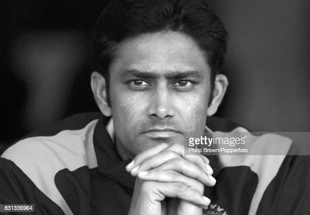 Anil Kumble of India waits for play to resume as rain stopped play during the second day of the 2nd Test match between India and England at Mohali...