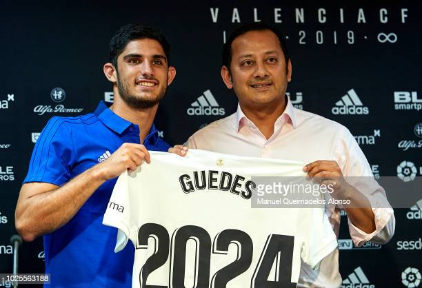 Anil Murthy president of Valencia CF and Goncalo Guedes pose during his presentation as a new player for Valencia CF at Mestalla Stadium on August 31...