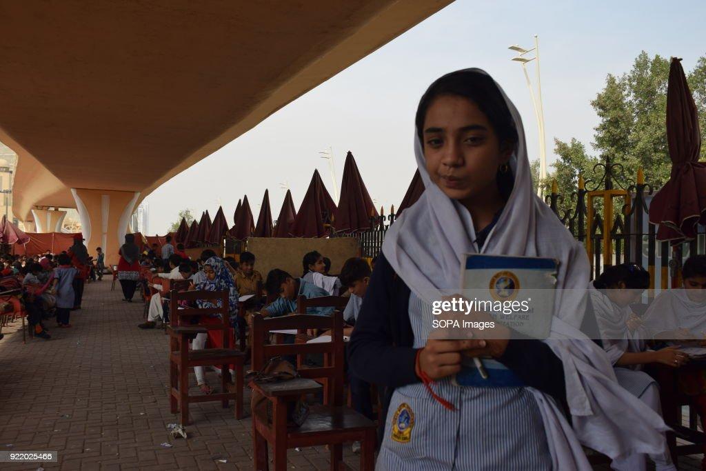 Anila Bibi 12, student of 4th grade in the Karachi FootPath... : News Photo