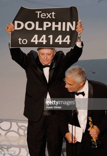 Animal activist Ric O'Barry and director Louie Psihoyos accept Best Documentary Feature award for The Cove onstage during the 82nd Annual Academy...