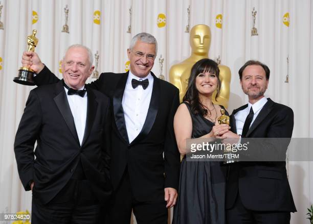 Animal activist Ric O'Barry director Louie Psihoyos and producers Paula DuPre Pesman and Fisher Stevens winners Best Documentary Feature award for...