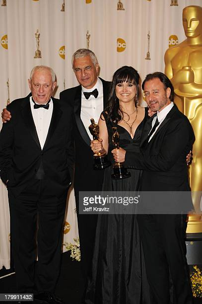 Animal activist Ric O'Barry director Louie Psihoyos producers Paula DuPre Pesman and Fisher Stevens accept Best Documentary Feature award for 'The...