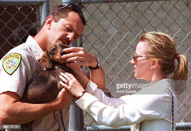 Animal Control Officer Pat Haskett shows Lauri Gros from LA the dachsund at Ventura County Animal Control She drove from LA and sat in her car for an...