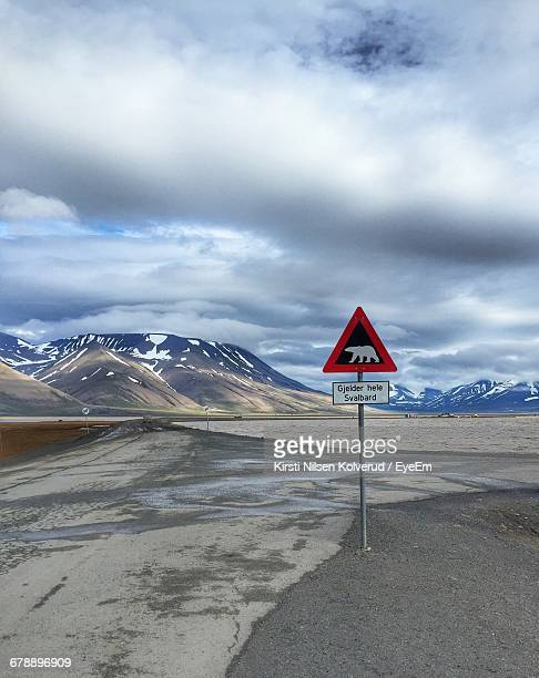 Animal Crossing Sign And Mountains Against Cloudy Sky In Winter