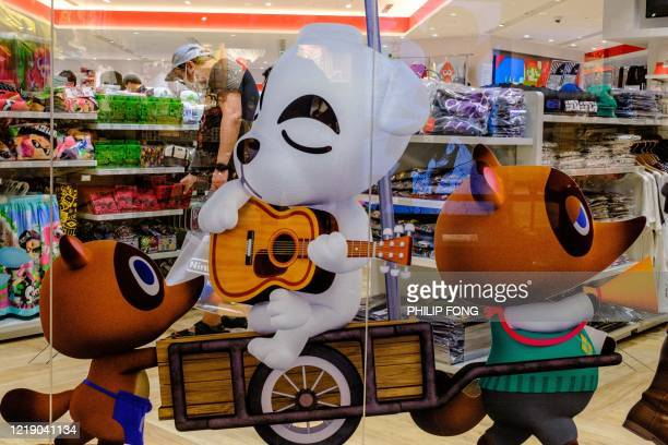 Animal Crossing video game characters are seen on display at a Nintendo store in Tokyo on June 10, 2020.