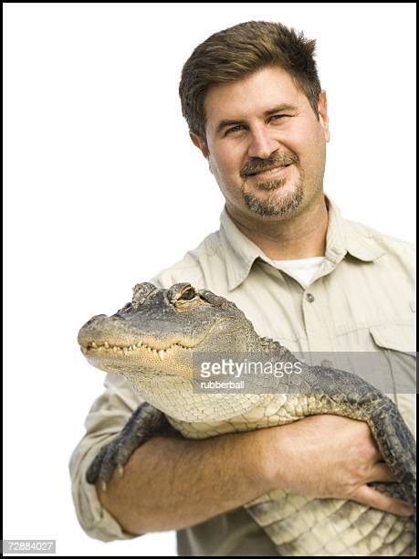 animal handler with alligator - zoo keeper stock pictures, royalty-free photos & images