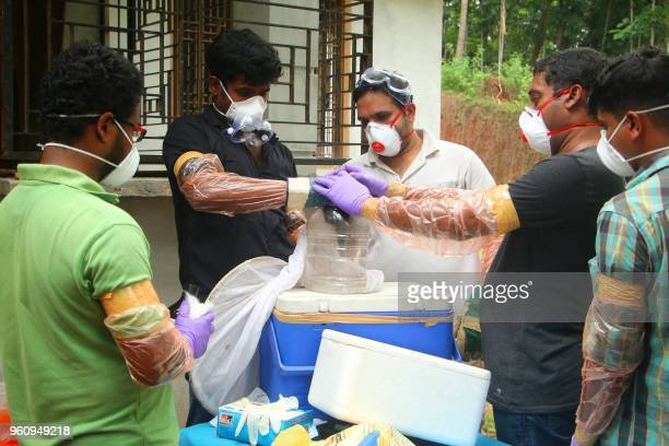 Animal Husbandry department and Forest officials deposit a bat into a container after catching it inside a well at Changaroth in Kozhikode in the...