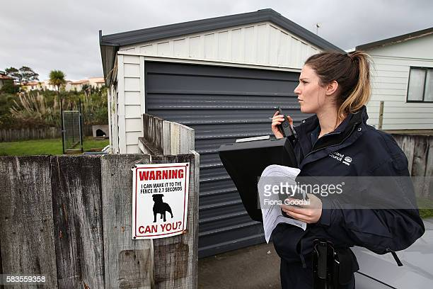Animal Management Officer Kelsey at a Ranui property on July 27 2016 in Auckland New Zealand The Auckland Council Animal Control undertook a menacing...