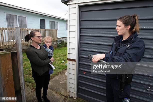 Animal Management Officer Kelsey speaks to a resident at a Ranui property on July 27 2016 in Auckland New Zealand The Auckland Council Animal Control...
