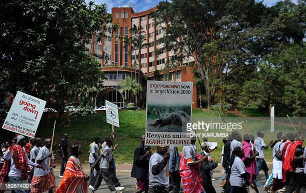Animal rights activist group Kenyans United Against Poaching members shout during a protest on January 22, 2012 in the Kenyan capital, Nairobi to put...