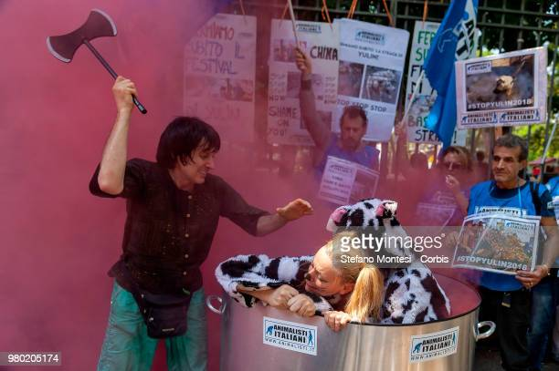 Animal rights activists demonstrate near the Embassy of China to protest against the Festival of Yulin on June 21, 2018 in Rome, Italy. Yulin is a...