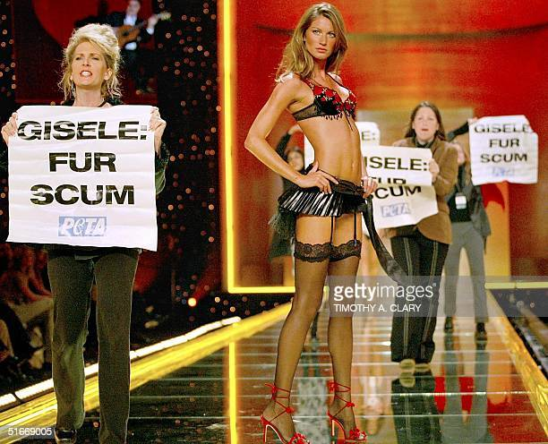 Animal rights activists from PETA rush the stage as supermodel Gisele Bundchen models an outfit during the Victoria's Secret 8th Aunnual Runway...