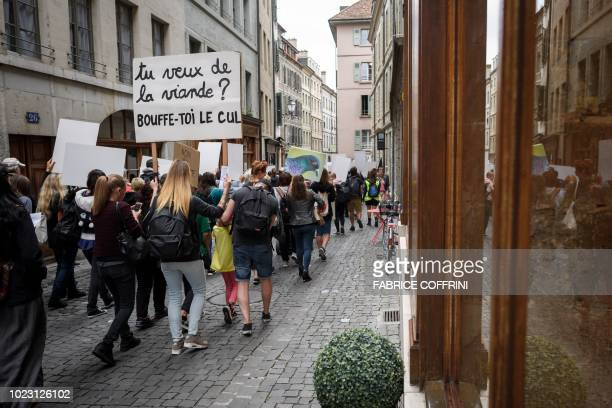 Animal rights activists hold a banner reading in French 'Do you want meat Eat your ass' during a protest of the antispeciesism association PEA on...