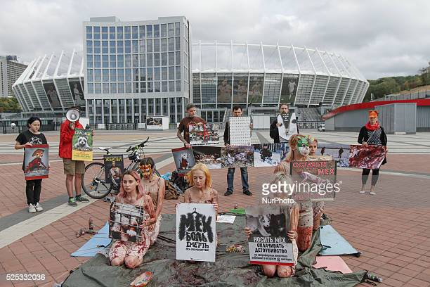 Animal rights activists hold a performance quotBloody Pilequot in downtown Kyiv on the eve of the annual campaign quotFur – for animals March for...
