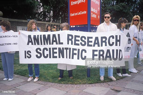 Animal rights demonstrators holding signs Los Angeles California