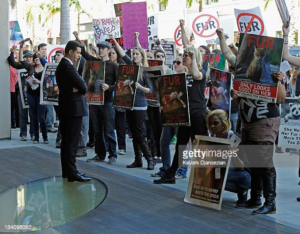 Animal rights groups and PETA stop in front of a Prada store on Rodeo Drive during an anti-fur demonstration urging Black Friday shoppers to stop...