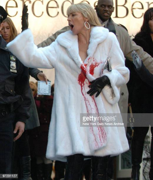 animal rights protester throws blood in this scene on the white fur coat that Kim Catrall was wearing at the filming of Sex And The City at Bryant...