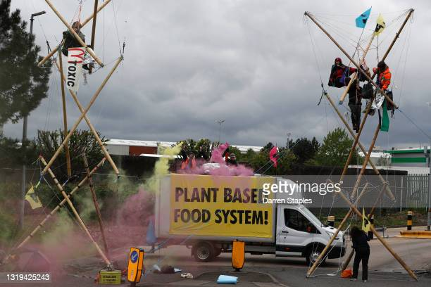 Animal rights protesters from Animal Rebellion blockade a McDonald's distribution centre to stop deliveries to the fast-food chain's 1,300 UK outlets...