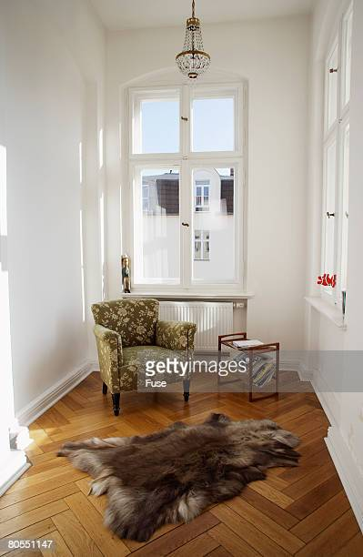 animal skin rug on wood floor in sitting room - magazine rack stock photos and pictures