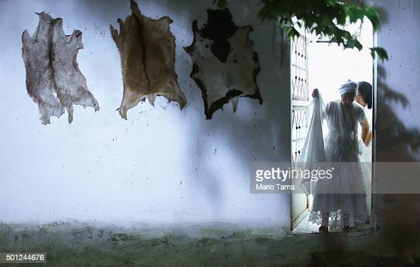 Animal skins hang on a walll outside a Candomble ceremony honoring goddesses Iemanja and Oxum on December 13 2015 in Itaborai Brazil Candomble is an...