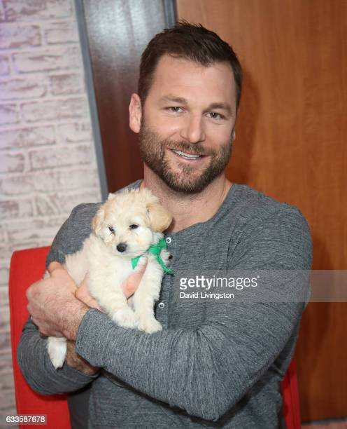 Animal trainer Dave Salmoni poses with a puppy at W Hollywood on February 2 2017 in Hollywood California
