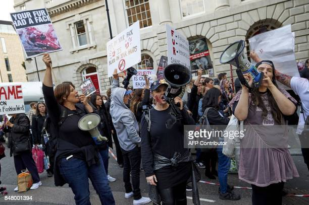 Animal welfare protestors demonstrate outside a venue before a show by British fashion house Burberry on the second day of The London Fashion Week...