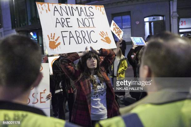Animal welfare protestors hold up placards outside a venue after a show by British fashion house Burberry on the second day of The London Fashion...