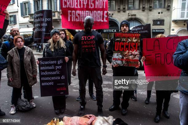 Animalrights activists protest during the Milan Fashion Week against the use of fur coats in the fashion industry in Milan Italy on 24 February 2018