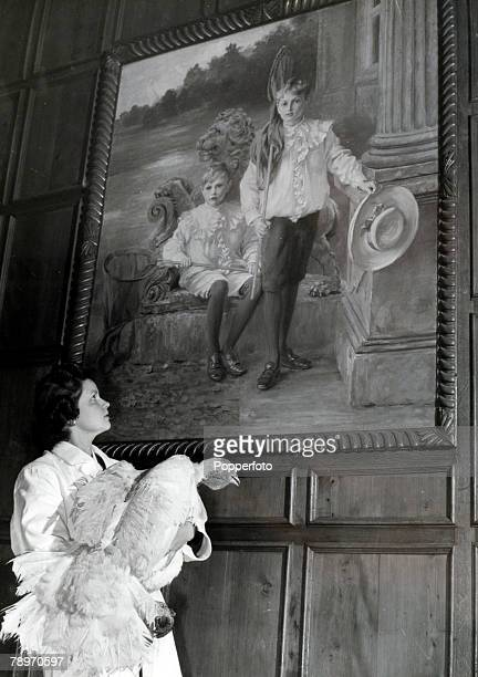Animals Birds/Poultry Food Turkeys pic circa 1950's Great Witchingham Norfolk England Mrs Matthews holds a turkey while she gazes at a large painting...
