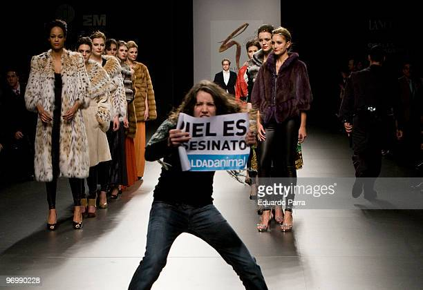 Animals rights campaigners protest against the use of fur in the garments with the slogan 'fur is murder' at Jesus Lorenzo show during Cibeles Madrid...