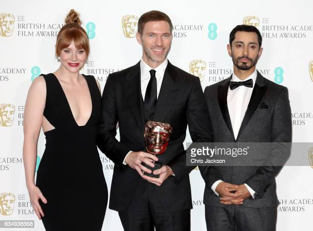 Animated Film Award winner Travis Knight and presenters Bryce Dallas Howard and Riz Ahmed pose in the winners room during the 70th EE British Academy...