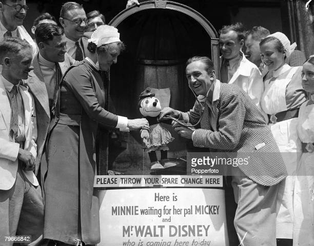 Animation and Cartoons 24th June 1935 American animator Walt Disney tests Minnie Mouses heart as he inaugurates the Westminster Hospital Rebuilding...