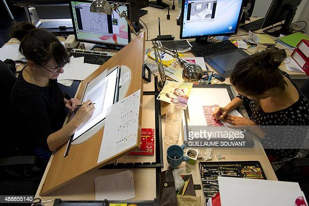 Animation artist and movie director work on an animated movie using a rostrum camera on September 17 at the new French center for animated movies in...